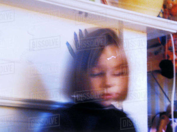 Portrait of a little girl looking down Rights-managed stock photo