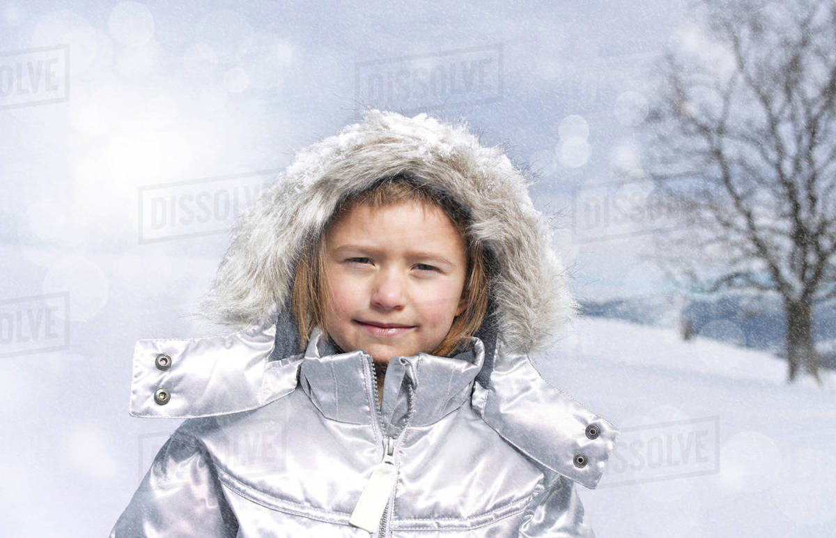 997995dae4a0 Portrait of young girl wearing winter coat - Stock Photo - Dissolve