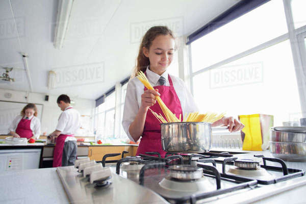 High school student cooking pasta in home economics class Royalty-free stock photo