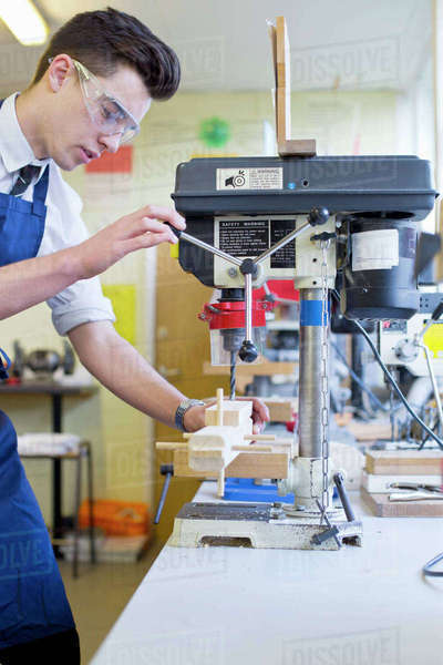High school student using drill in woodworking class Royalty-free stock photo