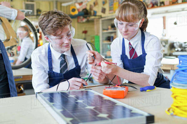 High school students testing electronics in shop class Royalty-free stock photo