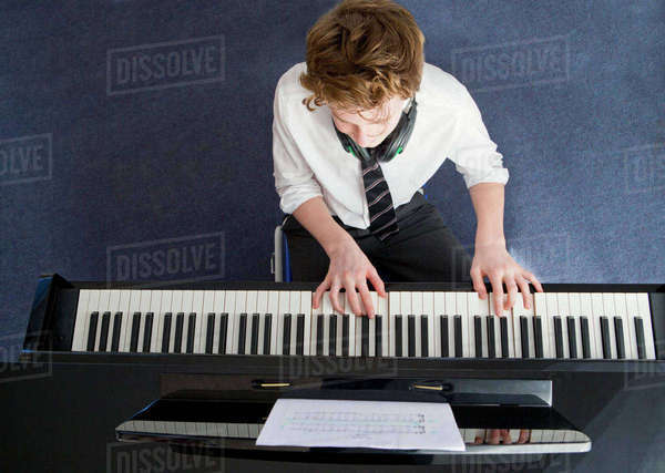 High school student playing piano in music class Royalty-free stock photo
