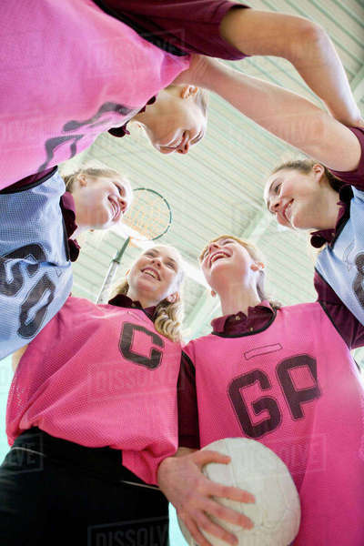 High school students talking in huddle before netball game Royalty-free stock photo