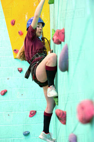 High school student climbing rock climbing wall Royalty-free stock photo