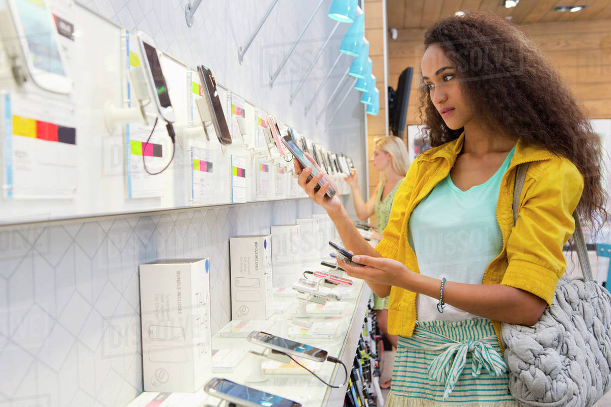Young woman browsing in phone store Royalty-free stock photo