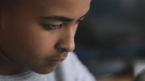 Hand-held shot of a boy using a tablet Royalty-free stock video