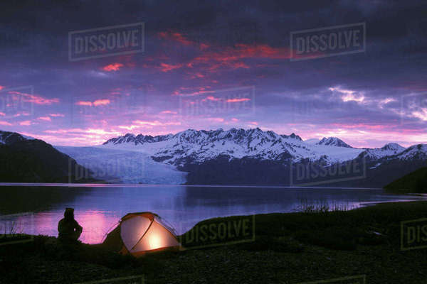 Kayaker Tent Camping At Dusk Pederson Glacier Kenai Fjords National Park Kenai Peninsula Alaska Rights-managed stock photo