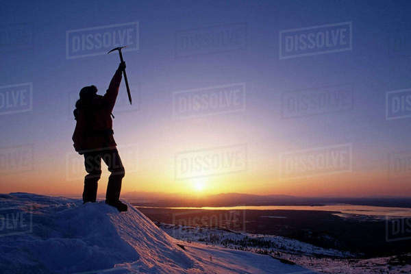 Climber Victorious At Top Of Chugach Mts Sunset Southcentral Alaska Rights-managed stock photo