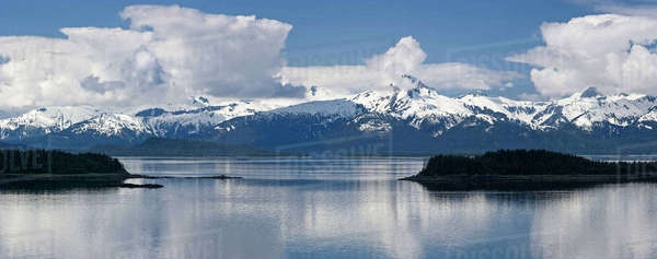 Clouds Parting On A Summer Morning Over Lynn Canal And The Chilkat Mountains In Southeast Alaska's Inside Passage Near Juneau. Rights-managed stock photo