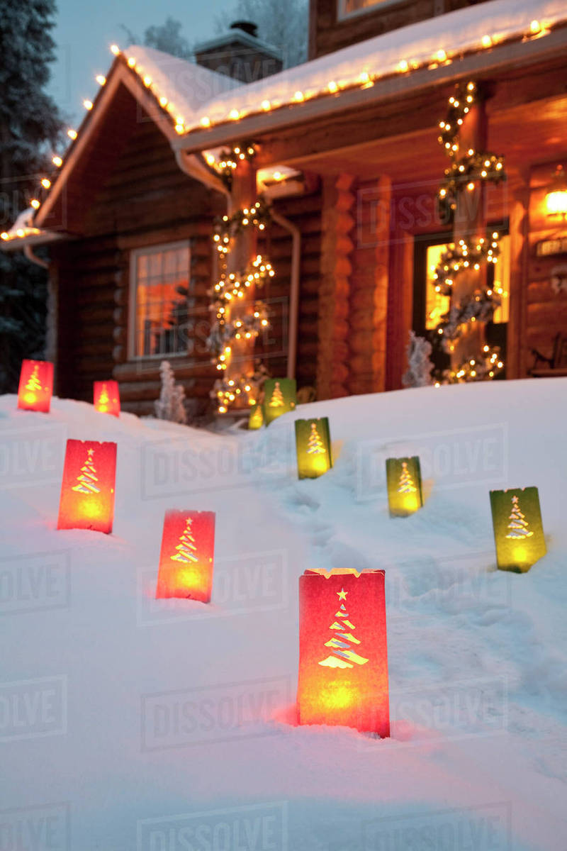Log Home Decorated With Christmas Lights And Luminaries On The ...