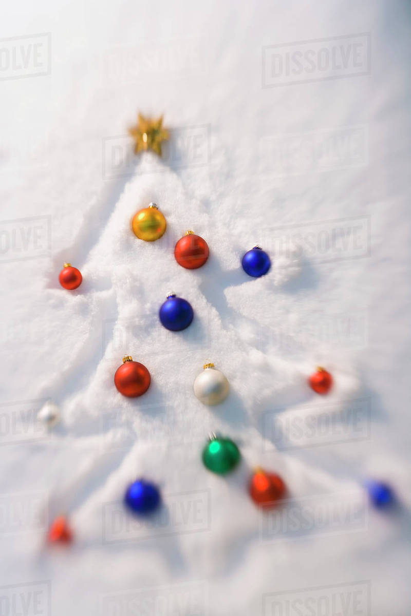 Christmas Tree Outlined In A Fresh Blanket Of Snow With Multi ...
