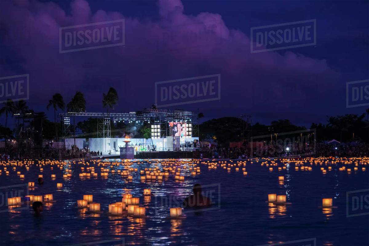 floating lanterns at the lantern floating hawaii ceremony in ala