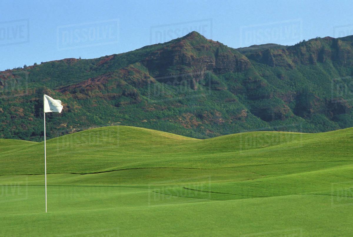 Hawaii Kauai Kauai Marriott Golf Course Rolling Hills With Mountains In Background White Flag Stock Photo Dissolve