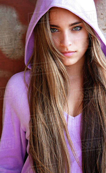 Hawaii, Oahu, Beautiful Headshot Of A Exotic Woman Wearing A Lavendar Hoodie. Rights-managed stock photo