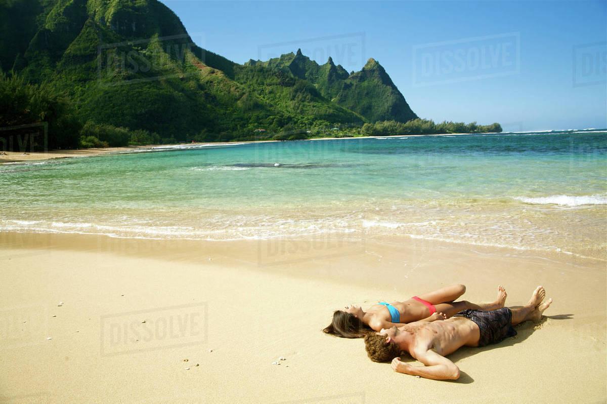 Hawaii Kauai Tunnels Beach Beautiful Couple Laying On The Beach