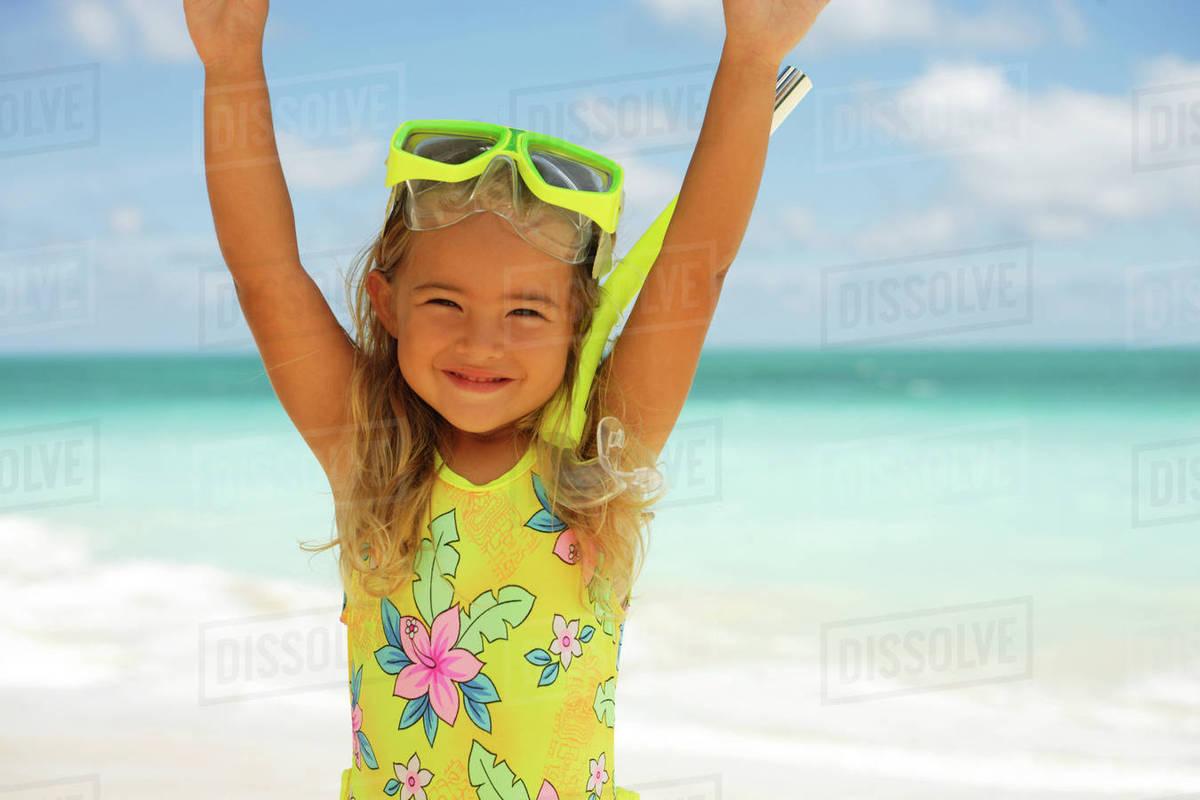 little girl pose beach Depositphotos