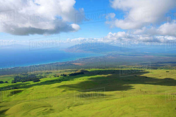Hawaii, Maui, Lush meadows of the Ulupalakua Ranch looking towards the central Maui isthmus and West Maui Mountains Rights-managed stock photo