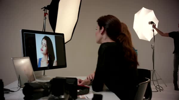 Female photographer discussing with fashion model at studio. Royalty-free stock video