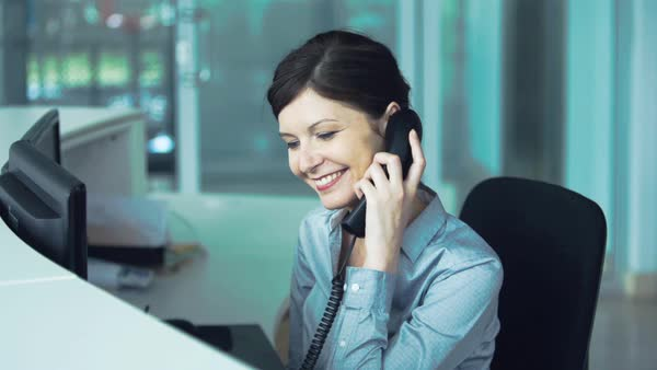 Office receptionist transferring phone call Royalty-free stock video