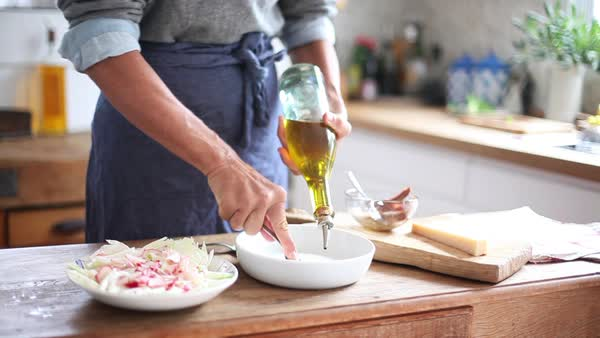 Woman preparing salad dressing Royalty-free stock video