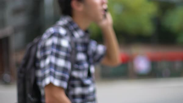 Young man chatting on phone while on the move in the city Royalty-free stock video