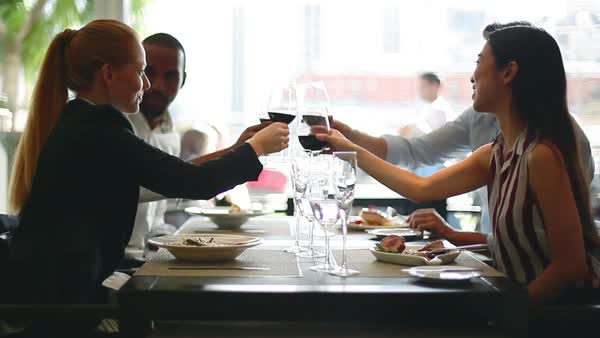 Friends clinking wine glasses in restaurant Royalty-free stock video