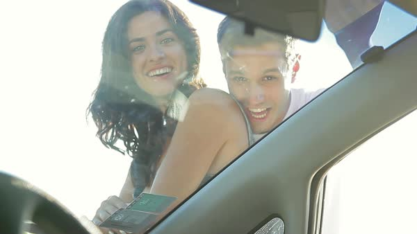 Couple smiling and waving through car window Royalty-free stock video