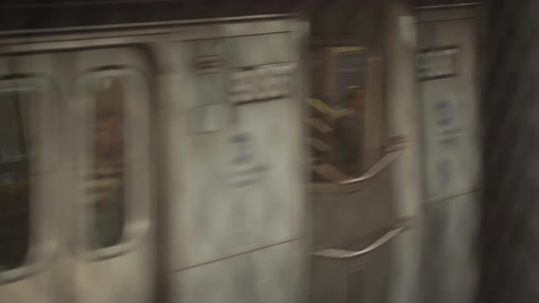 Subway train moving past wire fence Royalty-free stock video