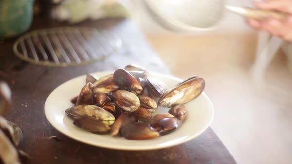 Serving freshly cooked mussels Royalty-free stock video