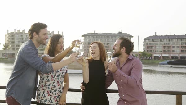 Friends clinking champagne glasses outdoors Royalty-free stock video