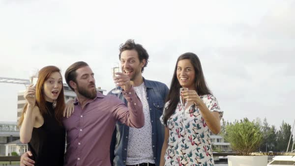 Group of friends celebrating with champagne outdoors Royalty-free stock video