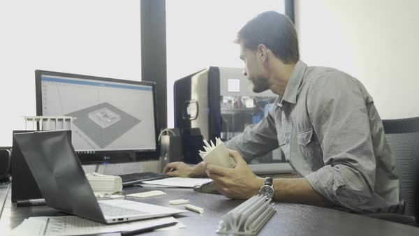 Engineer working on computer turning to smile at camera Royalty-free stock video