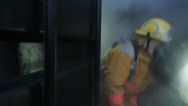 Fire fighters coming out of smoke fill container in rescue drill Royalty-free stock video