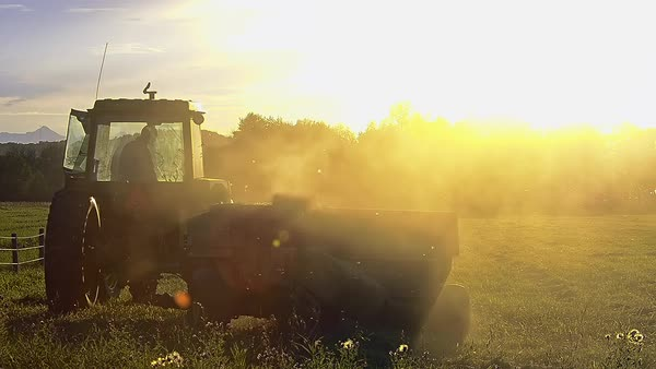 Medium shot of a hay baler at sunset Royalty-free stock video