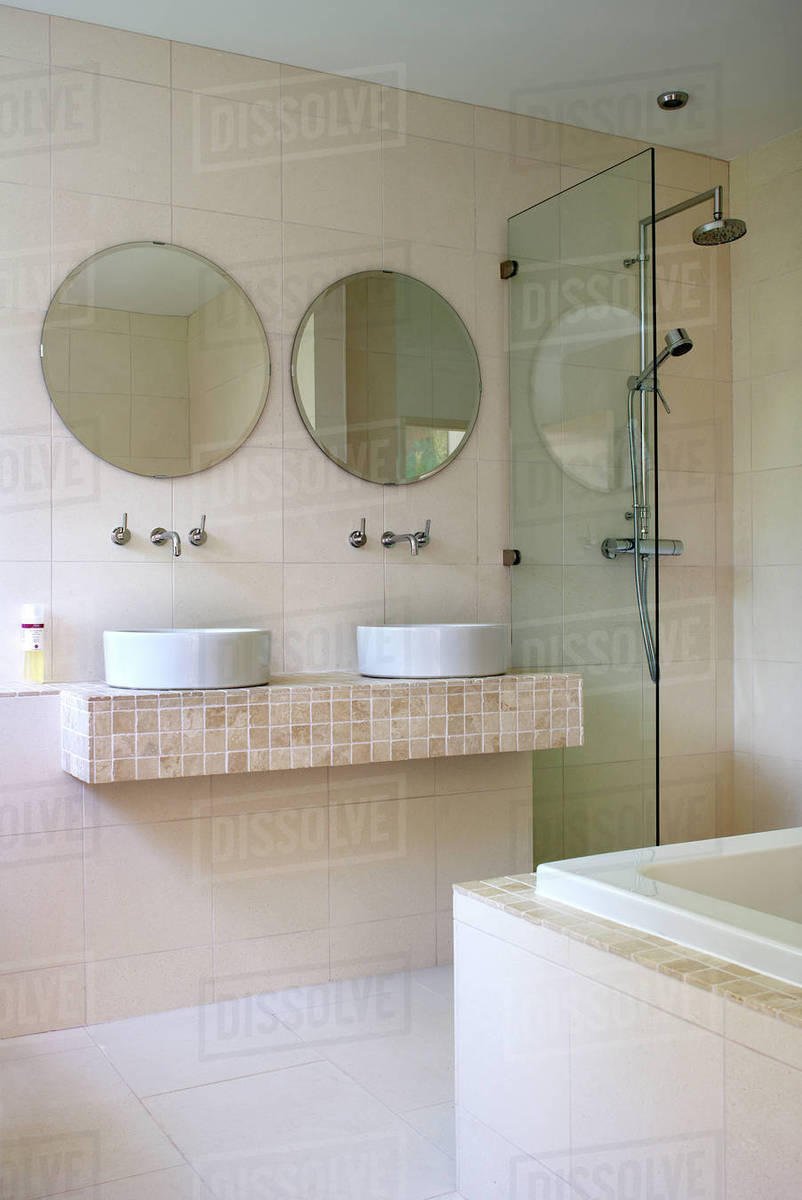 Double basin and shower cubicle in residential house - Stock Photo ...