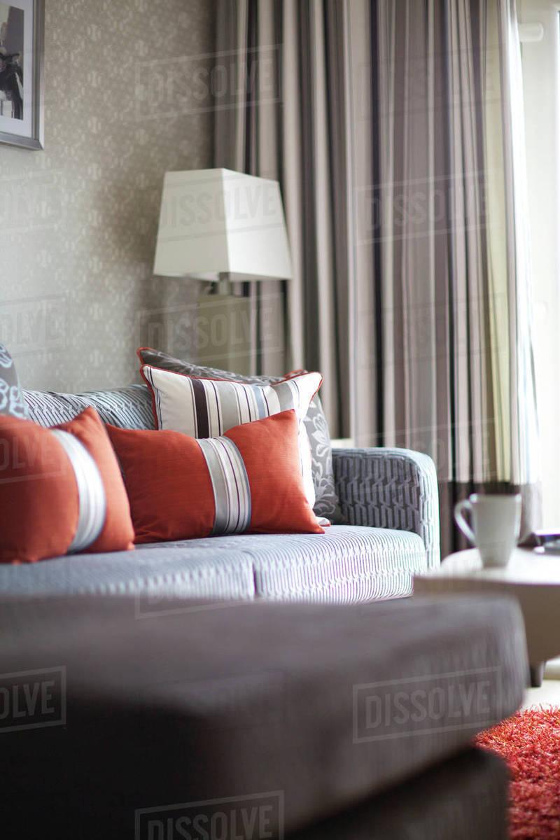 Orange Cushions On Grey Sofa