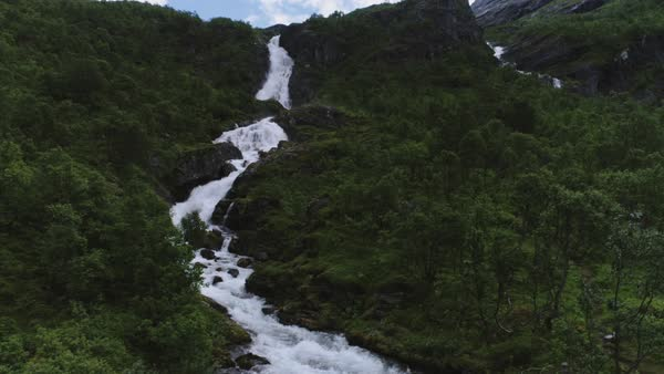Aerial shot of a stream tumbling down a mountainside in Norway Royalty-free stock video