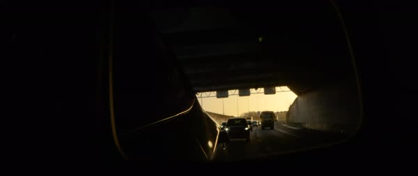 Hand-held shot of reflection of cars in a rearview mirror Royalty-free stock video