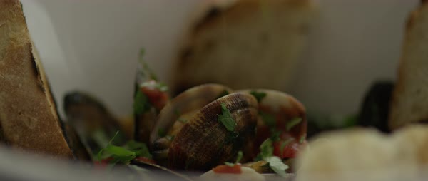Static shot of a person sprinkling herbs on sauteed mussels Royalty-free stock video