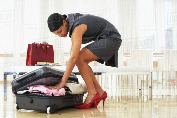 Woman Packing Suitcase Royalty-free stock photo