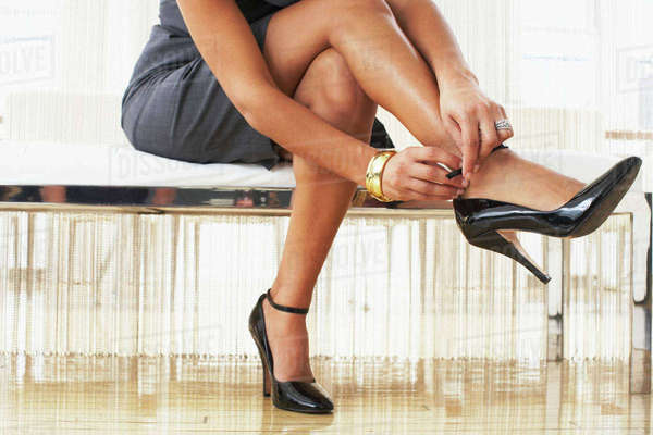 Woman Putting on Shoe Royalty-free stock photo