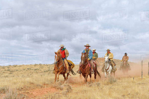 Cowboys and Cowgirl Riding Horses, Shell, Wyoming, USA Royalty-free stock photo