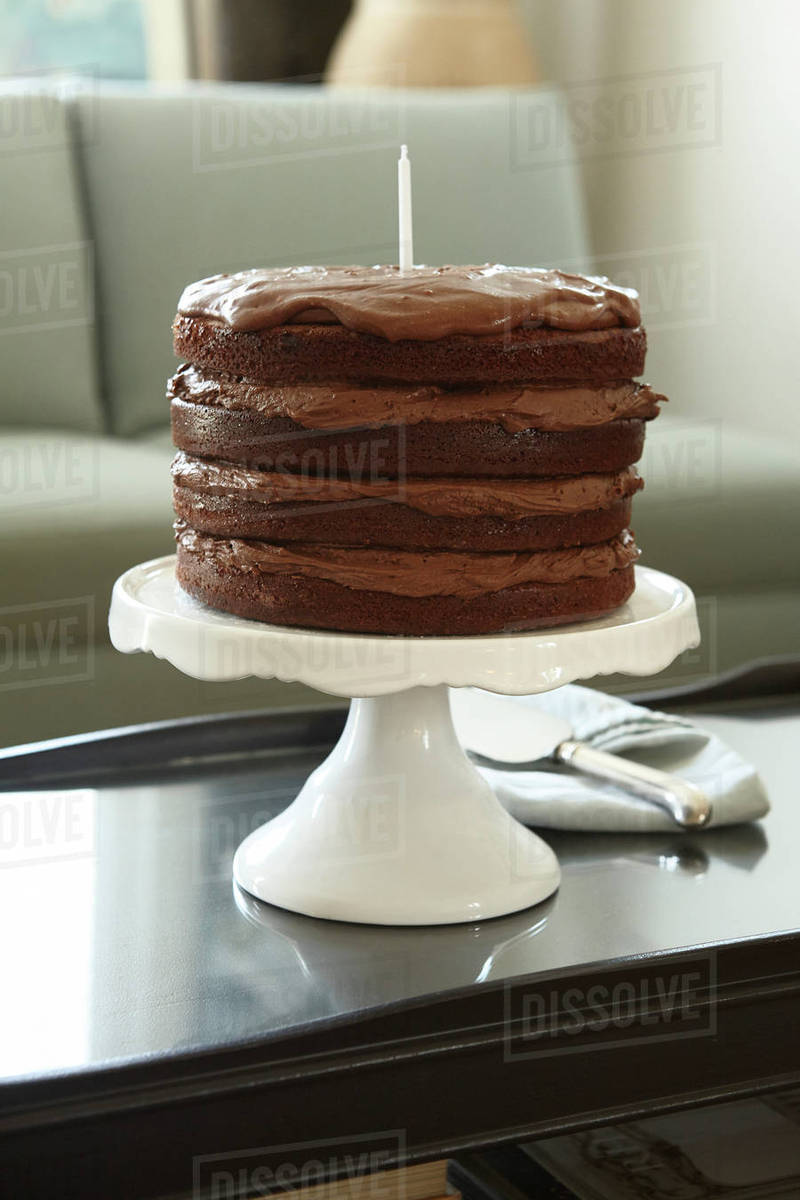 Strange Layered Chocolate Birthday Cake With Candle On Cake Stand On Funny Birthday Cards Online Kookostrdamsfinfo