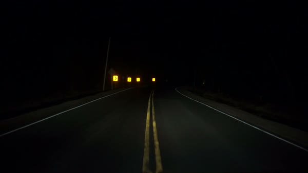Driving down a twisting and turning dark rural highway at night timelapse Royalty-free stock video