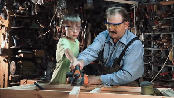 Man with boy making window frame Royalty-free stock video