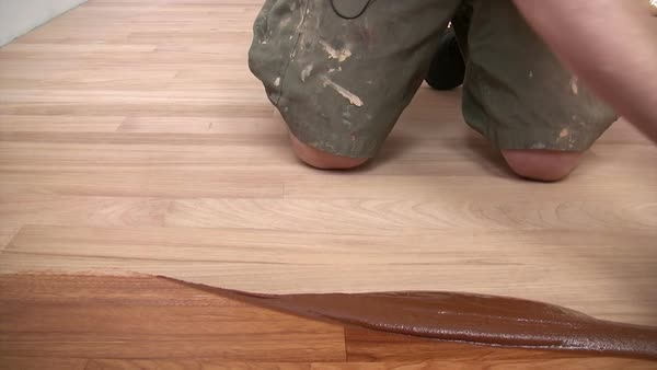 Parquet floor fitter waxing hardwood Royalty-free stock video