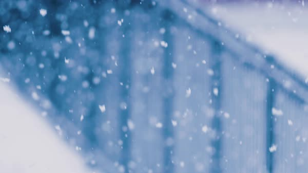 Snowfall in front of a iron fence. Royalty-free stock video