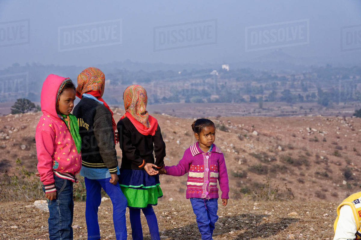 Indian children hanging out in a rural hilltop fair. Royalty-free stock photo