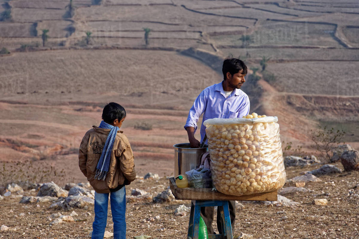 A man is selling Indian street food on hilltop. Royalty-free stock photo