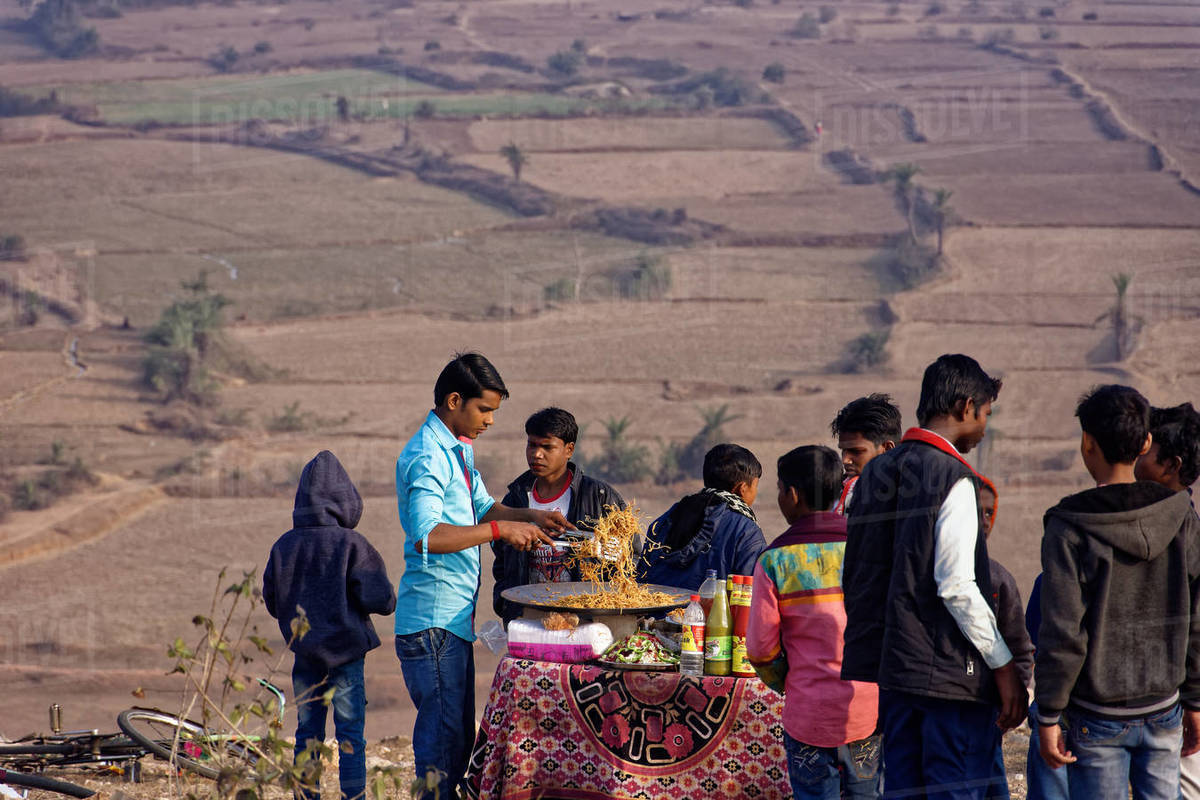 A noodles seller is cooking on a hilltop rural fair. Royalty-free stock photo